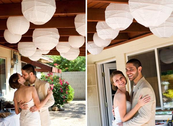 backyard wedding wedding couple kiss lanterns