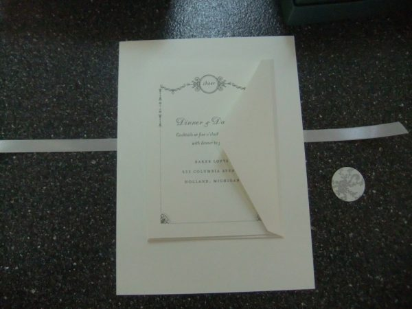 ribbon wrapped wedding invitations