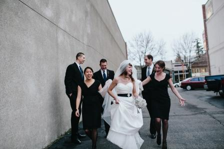 Our bridal party! The buys rented suits and my maids picked out black dresses. Their tights had small polka dots and their jewelry included pearl dangly earrings and pearl bracelets with black bows.