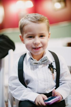 Our ring bearer Kolton wore suspenders and a gray bowtie and looked precious. We're proud of him for making it down the aisle.