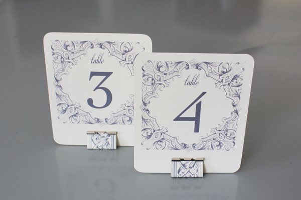 Diy table numbers holders the budget savvy bride for Table numbers