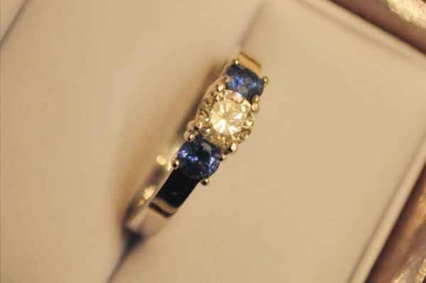 diamond flanked by sapphires