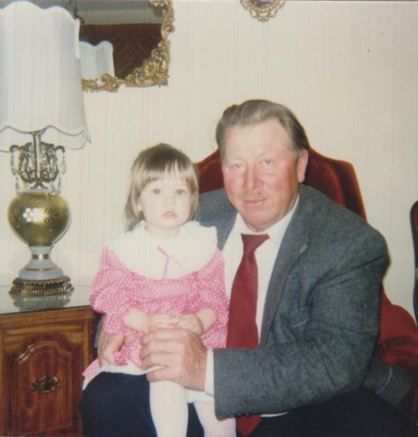My grandpa, with little me on his lap.