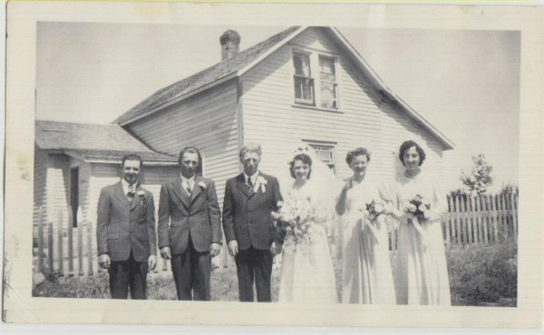 My grandparents and their wedding party on their wedding day, at their house.