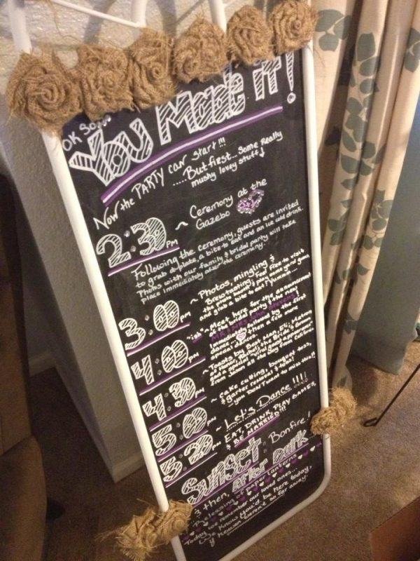 "An old tall mirror I had turned chalkboard to use as a reception ""itinerary"" (note the handmade burlap flowers!)"