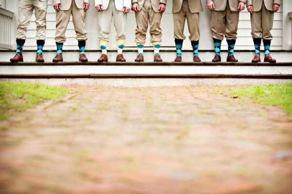 One of the gifts we gave the groomsmen were their cashmere socks! Loved this photo! :)