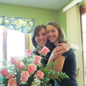 My MOH and me with one of the bouquets we made for the church using the remaining roses.