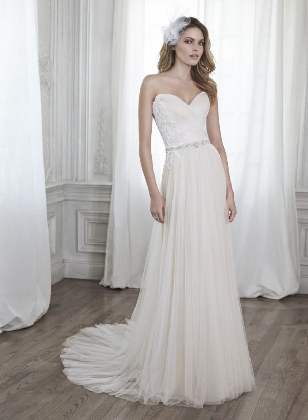 Maggie Sottero - Patience - $998 This stunning tulle sheath gown is accented with dainty lace appliqués on the bodice and a delicate Swarovski crystal waist. Finished with sweetheart neckline and corset back closure.