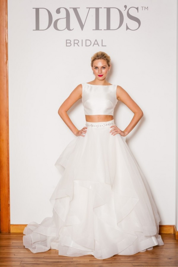 David's Bridal style SWG687 - $1299 Crop top wedding gown!! A simple and chic top paired with a voluminous tulle ruffled skirt makes a modern and bold statement - perfect for an art gallery wedding!