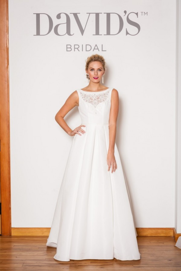 David's Bridal Style WG3709 - $699 This classic and demure style is reminiscent of Audrey Hepburn - but the peekaboo lace along the bust brings with it an updated and modern vibe.
