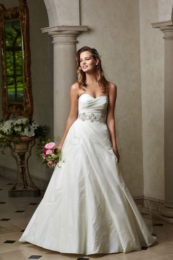 Wtoo by Watters - Virginia - $1010 This sophisticated, shimmer taffeta ballgown features a sweetheart neckline, dramatic asymmetrical side ruching, covered buttons and crystal beaded belt (included). Belt also sold separately as style 14902. Chapel train. Perfect for a classic bride.