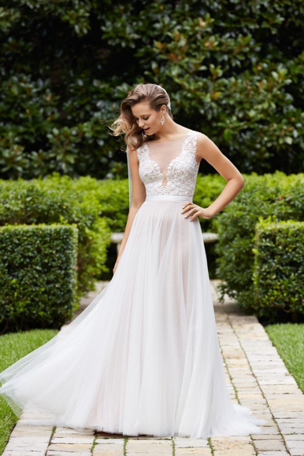 WToo by Watters - Marnie - $1100 Light and airy, this soft a-line gown features a plunging v-neck, beautifully sculpted with lace motifs on illusion and a dreamy soft net skirt with pearl buttons with a double-faced satin ribbon. Chapel train. Blown away by the subtle sexiness of this gown - truly stunning!