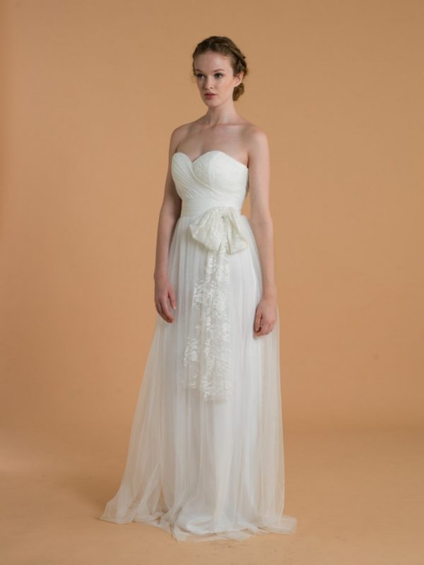Love, Yu Bridal - Penelope - $1,300.00 Ruched sweetheart tulle gown with lace bow for a romantic style.