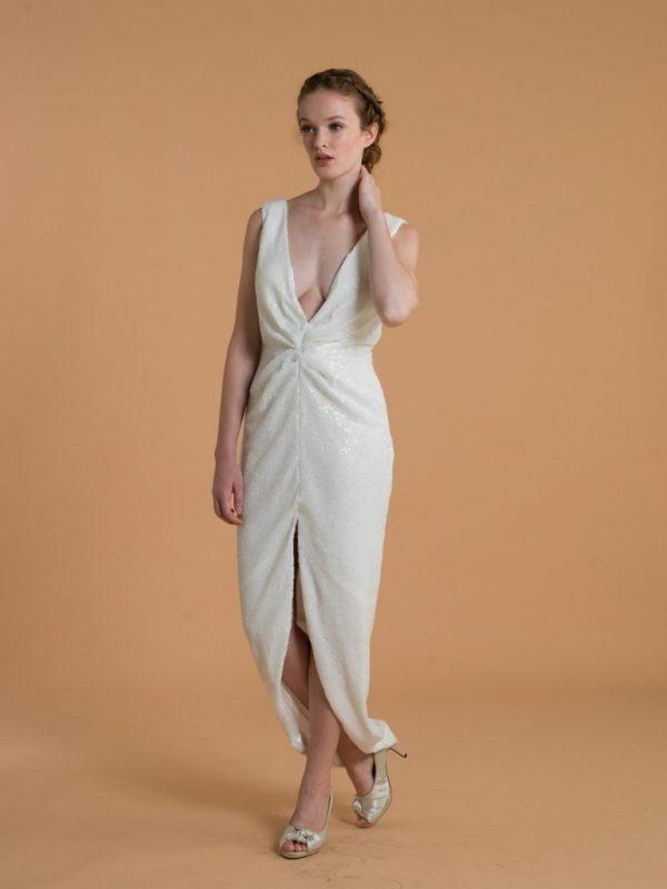 Love, Yu Bridal - Ellen - $800.00 Sleeveless plunging V neck, center slit dress. Sequin fabric is great for a bold bride looking for a sultry and glamorous style.