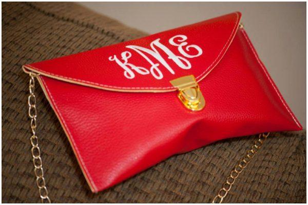 red monogrammed clutch