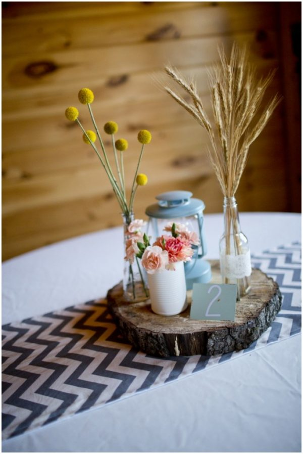 rustic wedding centerpiece wheat and tree rounds