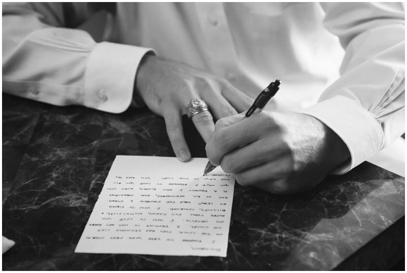 groom writing wedding letter