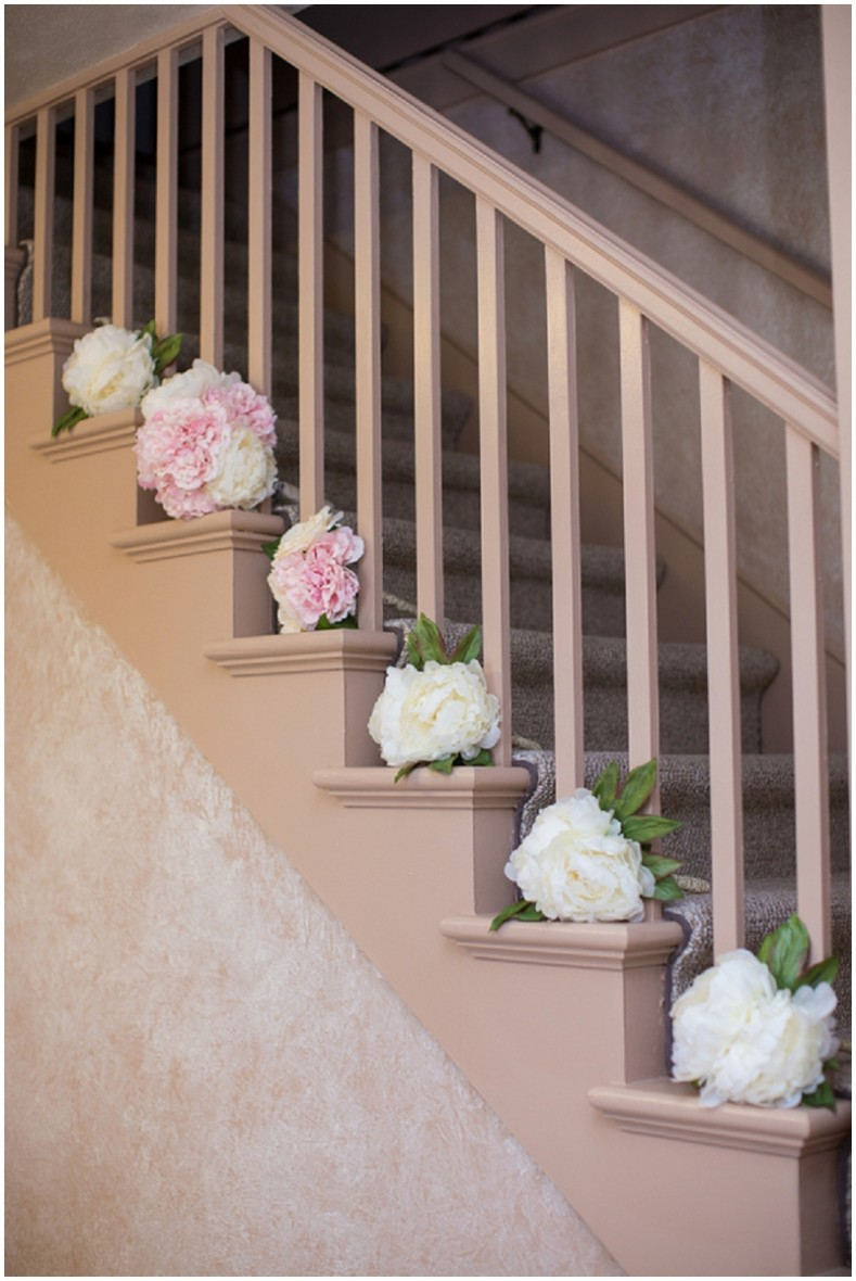 pink and white bouquets on staircase