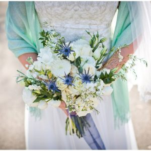 white bouquet with blue accents