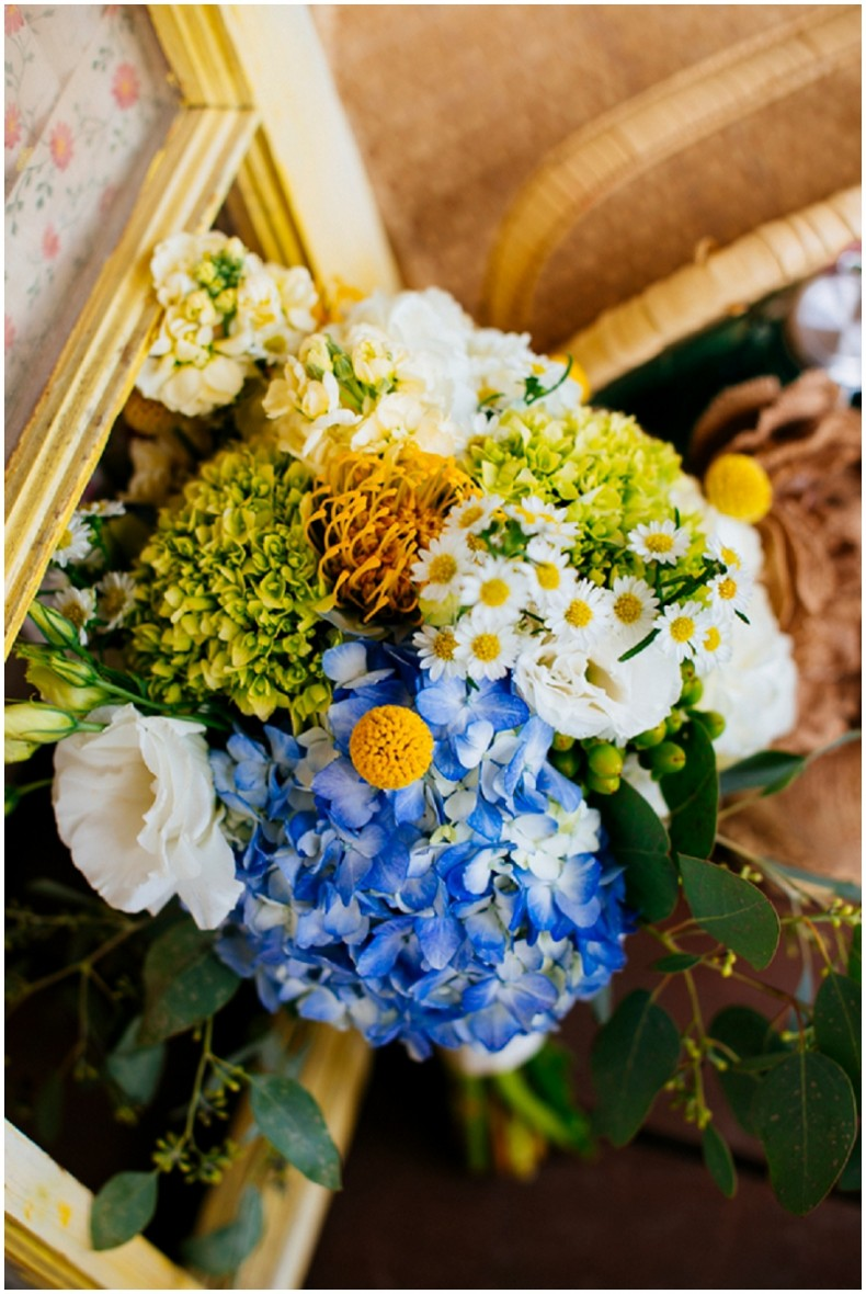 blue hydrangea and yellow flower bouquet