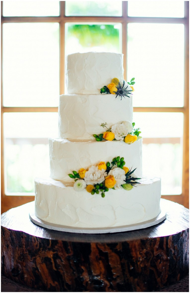 wedding cake with yellow accents