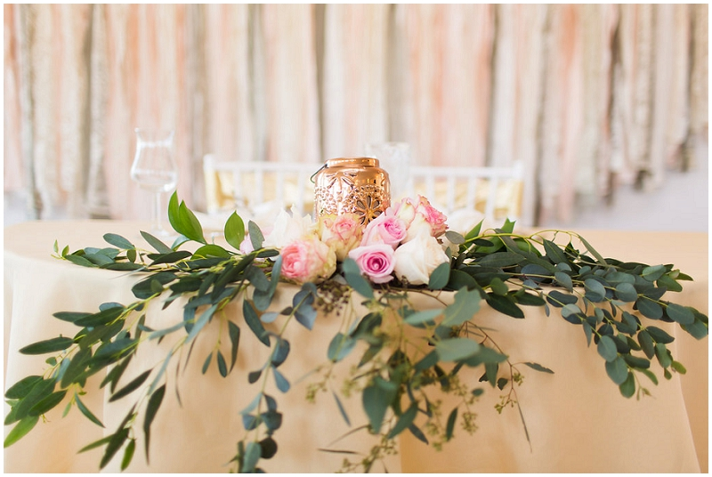 pink roses and greenery centerpiece