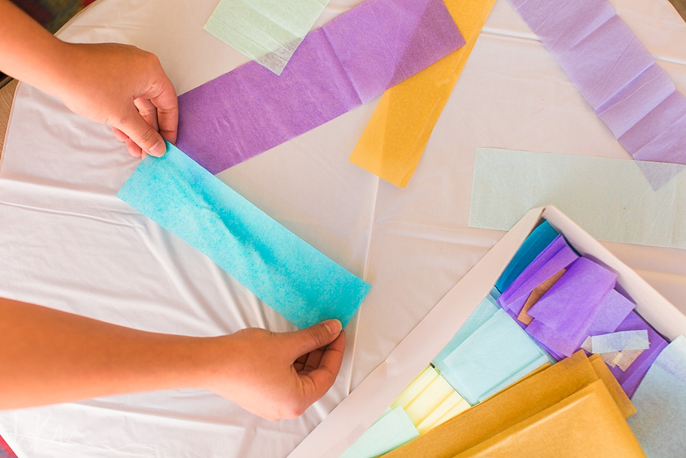glue tissue paper onto a tablecloth to make a photo backdrop!