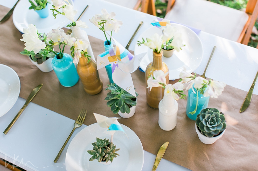 DIY styled shoot- painted bottle centerpieces by Pop The Champagne Events!