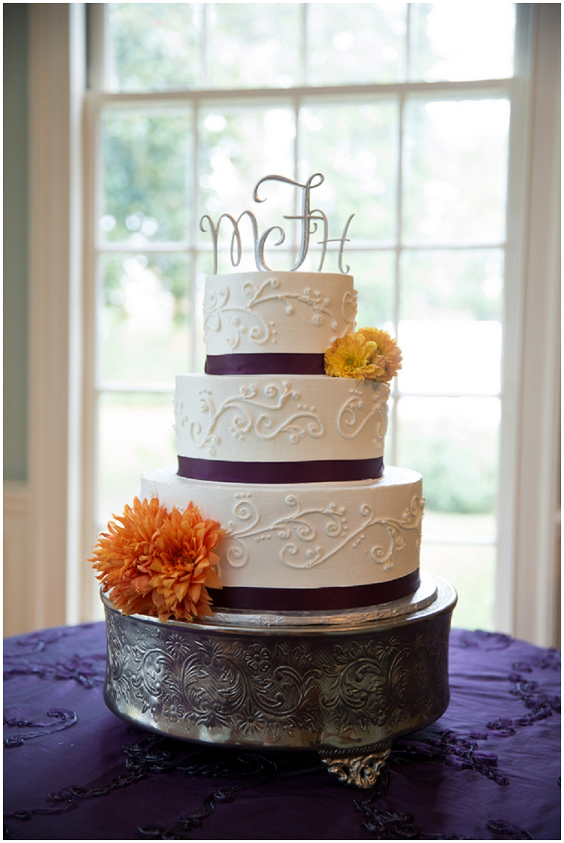 wedding cake with purple and orange  accents