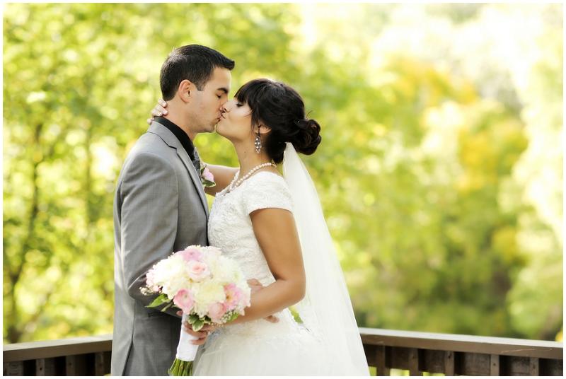 kissing outdoor wedding photos