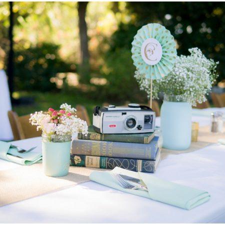 cameras and books wedding reception decor