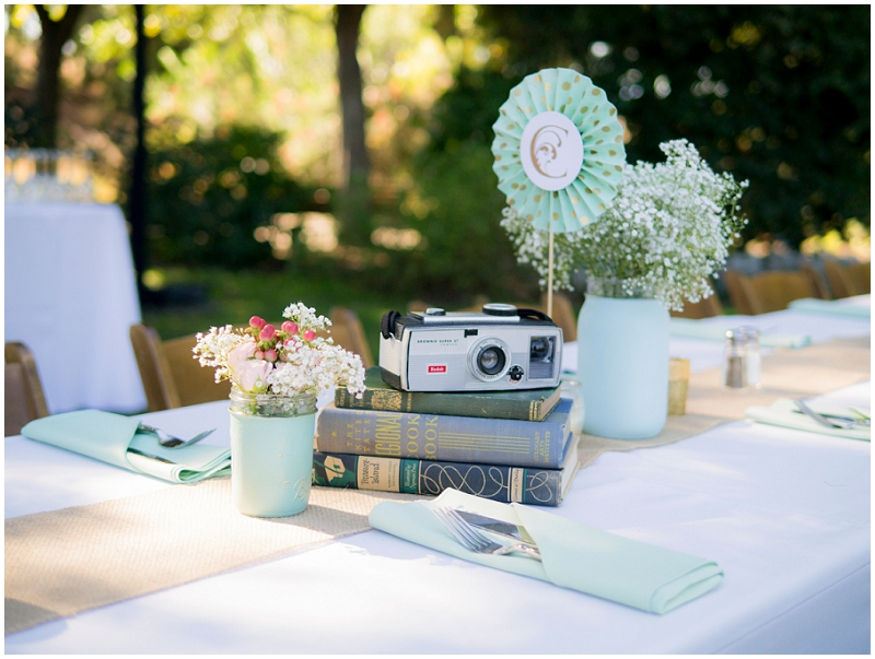 cameras and books wedding reception decor