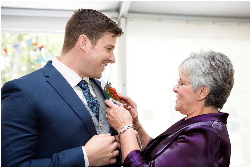 mother pinning on boutonniere
