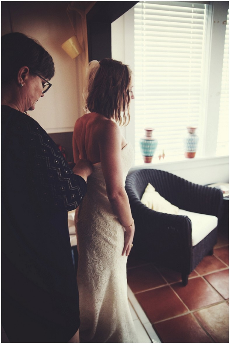 bride putting dress on
