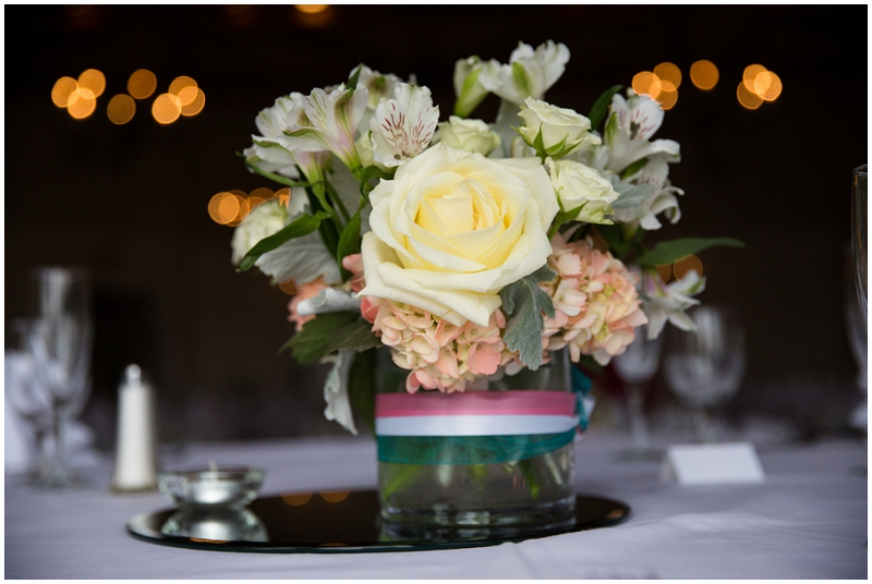 rose and mirror wedding reception flowers