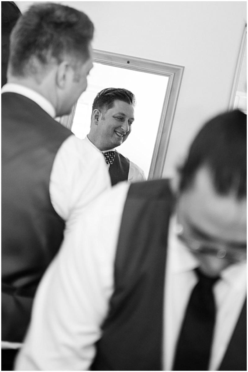 groom getting wedding dress