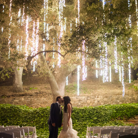 nighttime ceremony with lighting in the trees - so pretty!