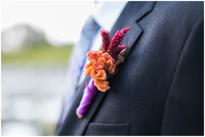 orange and purple boutonniere