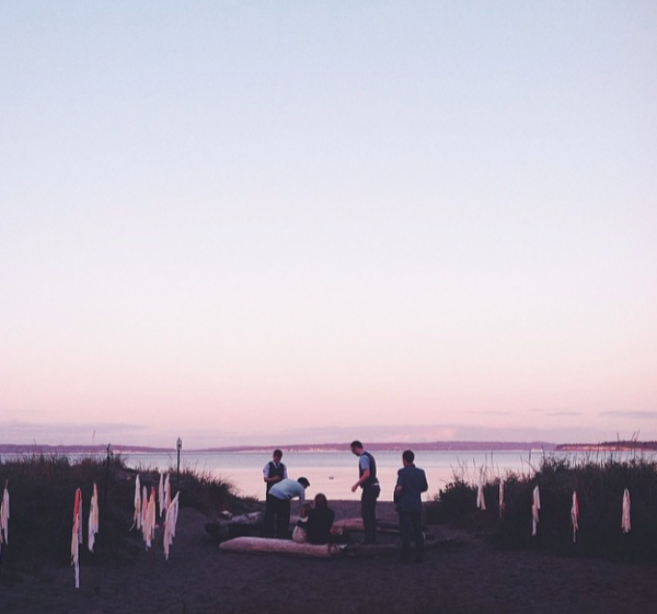 Friends setting up a post-wedding campfire at Fort Worden. Photo by the bride.