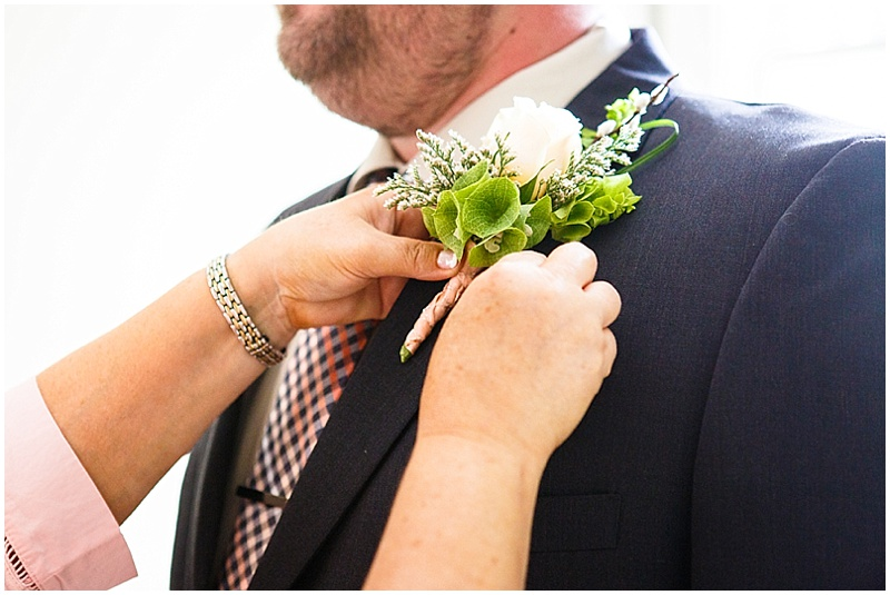 peach and navy wedding attire