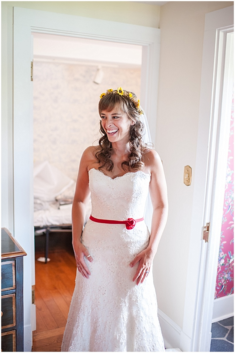 sweetheart wedding dress with red belt
