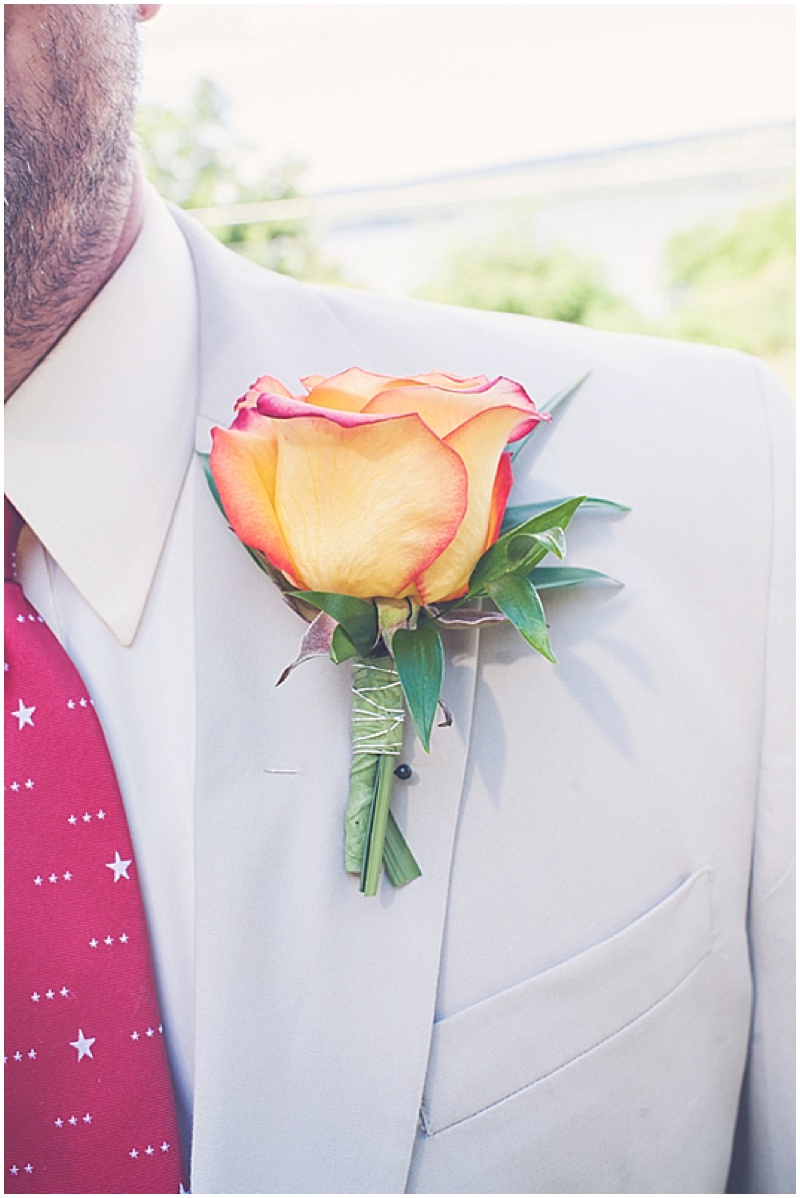 yellow and red rose boutonniere