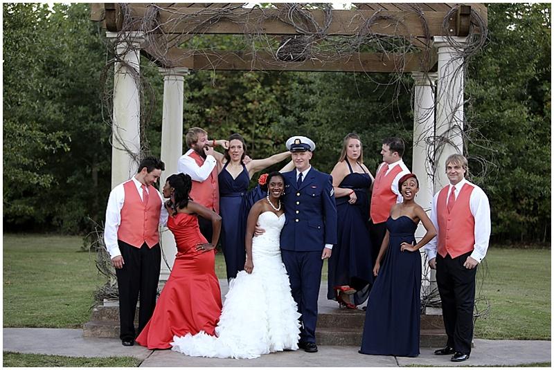 navy and coral wedding attire