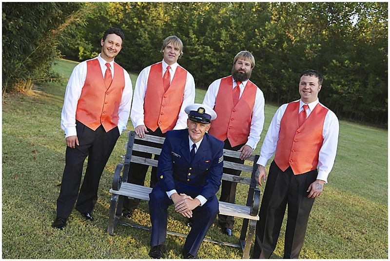 navy and coral wedding attire