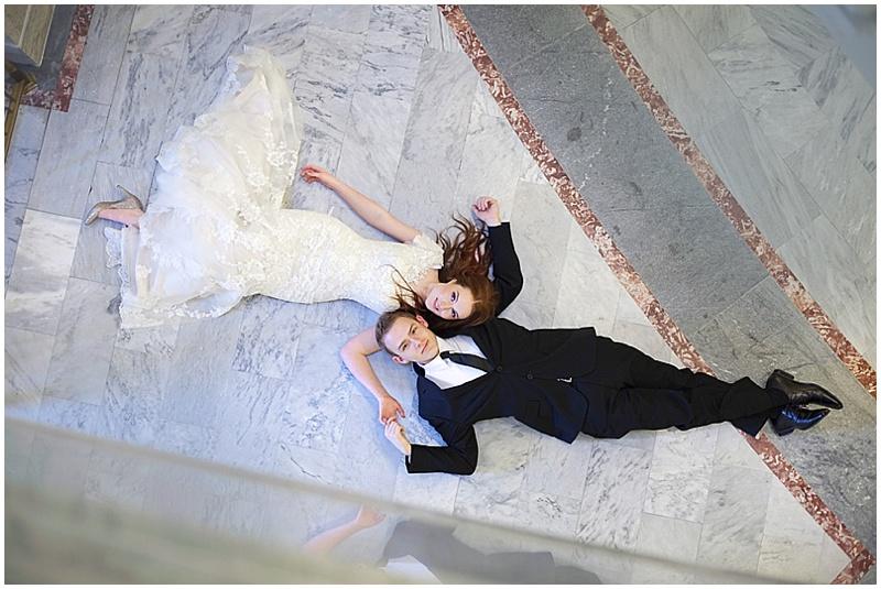 laying down wedding photos