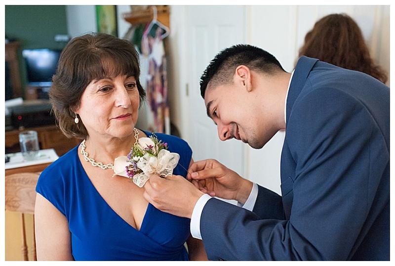 groom pinning corsage