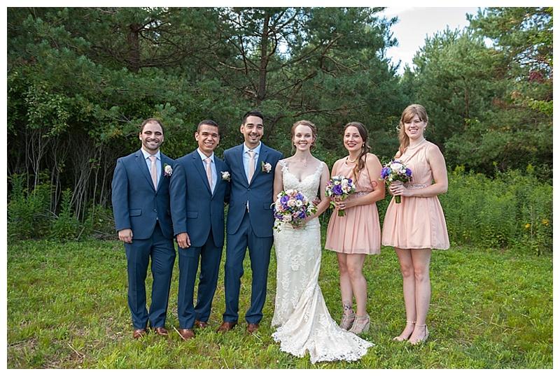navy and pink wedding attire