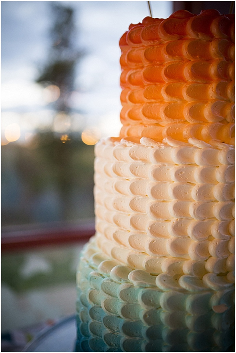 teal and orange ombre cake