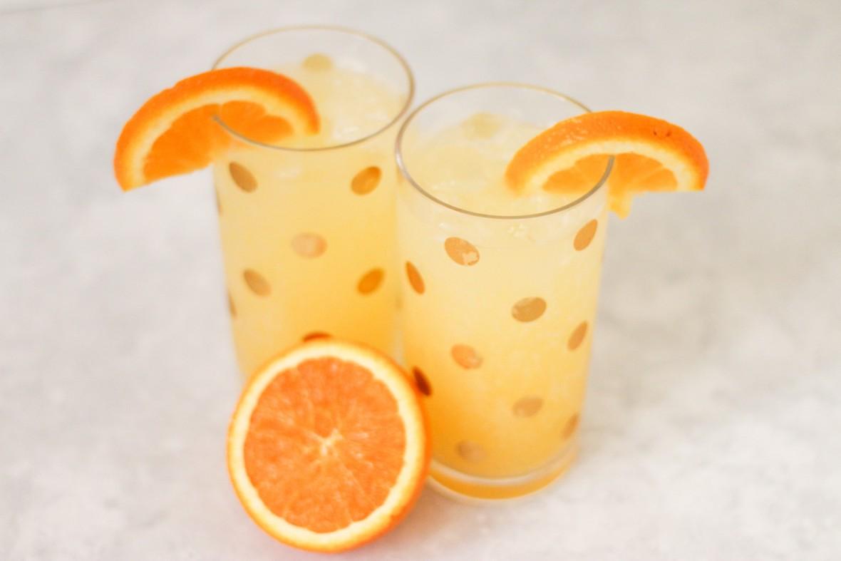 Savvy Signature Sips | Cocktail Recipe | Skinny Girl Tangerine Vodka, Soda Water, and a Splash of Orange Juice!