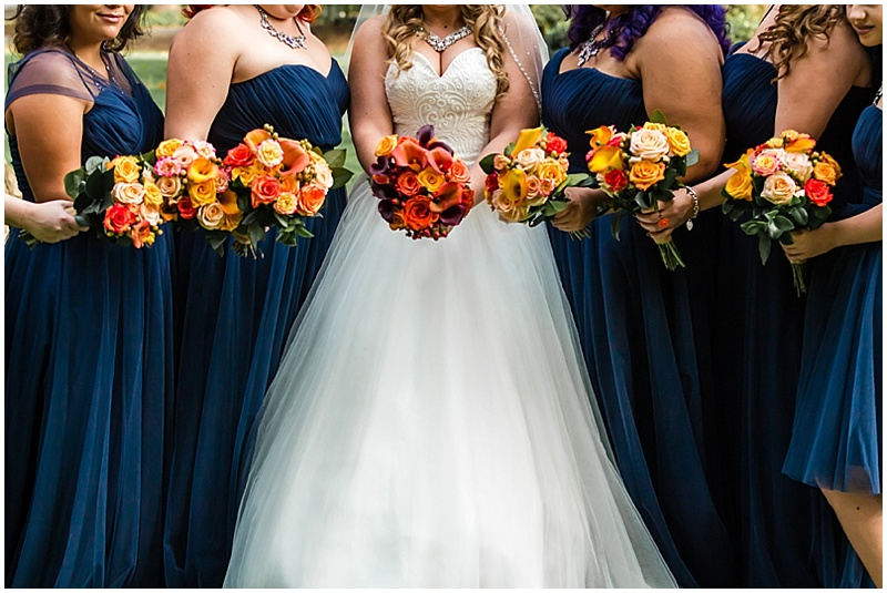 navy and orange wedding attire